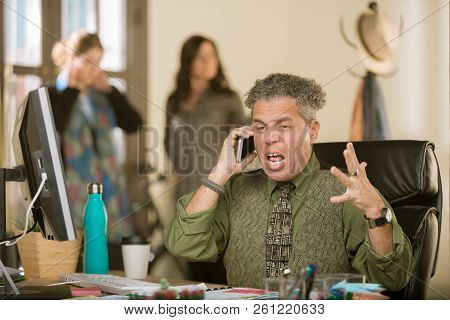 Mature Professional Man Yelling On The Phone