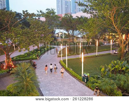 Jakarta, Indonesia - August 29, 2018: A Few Of People Strolling Around Tribeca Park At Central Park
