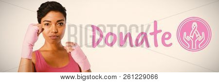 Graphic image of donate text with breast cancer awareness ribbon against young woman for breast cancer awareness