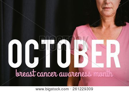 Pink breast cancer awareness text against  mature women in pink for breast cancer