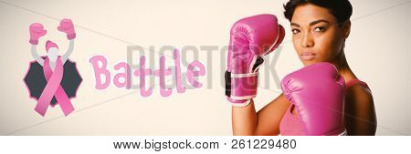 Battle text with female likeness and breast cancer awareness ribbon against side shot of woman fighting against breast cancer