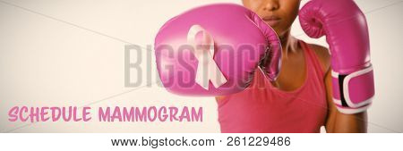 Schedule mammogram text with breast cancer awareness ribbon against woman for fight against breast cancer