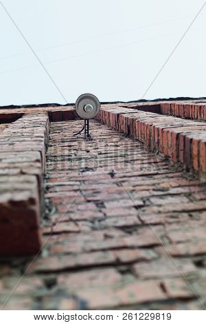 View From Below Of Street Lamp On Aged Old Red Brick Wall, Stock Photo Image
