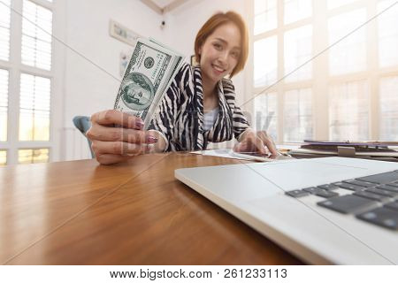 Business And Finance Concept Of Office Working, Businesswoman Holding Dollar Cash
