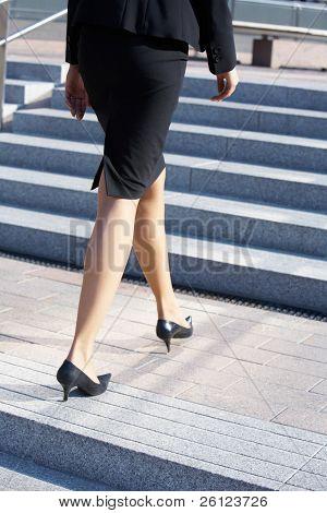 Businesswoman Walking On Stairway