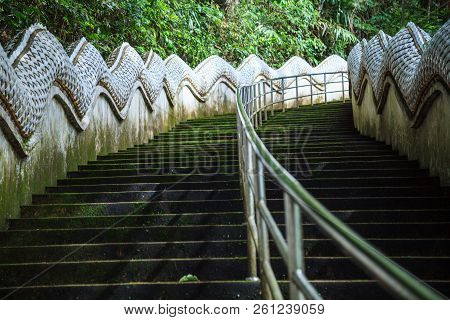 Safety Handrail help climbing up Two Naga Guardians stairway uphill to Wat Phra That Doi Tung temple, Chiang Rai, Thailand. Thai Travel Traditional and cultural Thai tourism, tourist destination. poster
