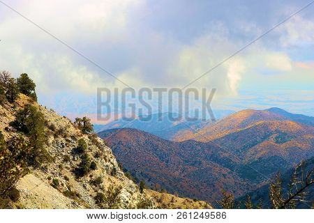 Rugged And Rocky Terrain With Pine Trees And Chaparral Shrubs Overlooking The Mojave Desert Taken In