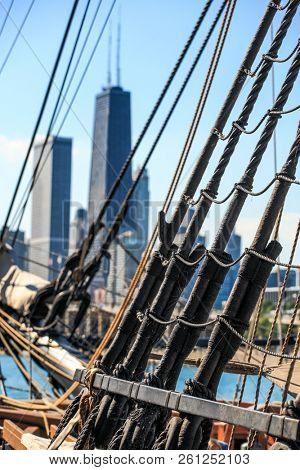 Rigging and ropes on a historic sailing ship downtown Chicago skline in the background poster