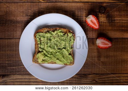 Toast with avocado spread and strawberry
