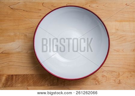 Empty plate on wooden able