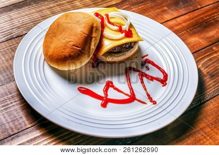 Home made burger on white plate
