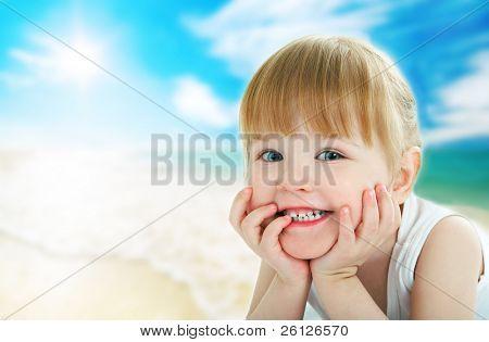 child on beach under sun