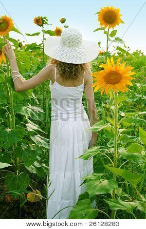 beauty woman in sunflower field