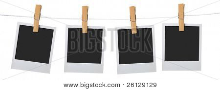 old photo frame attach to rope clothes peg over white background