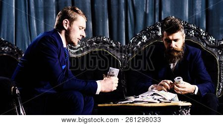 Business Partners With Serious Faces. Criminals In Elegant Suits Count Dollars. Financial Profit, Lu