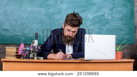 School Teacher Checking Homework Or Test. School Paperwork. Paperwork Part Of Teachers Life. Teacher