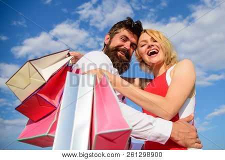 Shopping Brings Positive Emotions. Man Beard And Blonde Girl Enjoy Buy Clothing. Family Bought Excel