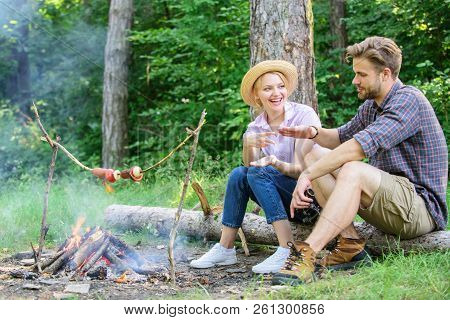 Hand Gesture Game Decide Who Win. Couple Tourists Throwing Their Gesture While Sit Log Near Bonfire.