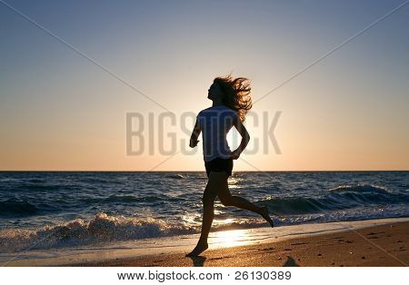 beauty woman run on sea beach on sunset