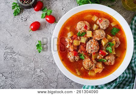 Hot Stew Tomato Soup With Meatballs And Vegetables Closeup In A Bowl On The Table. Albondigas Soup,