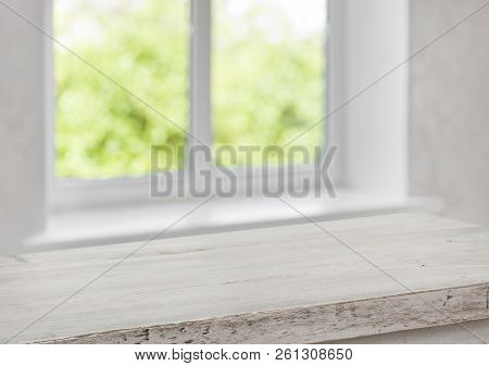 Desk Of Free Space With Blurred Summer Window As Background