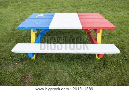 Picnic Table Painted With Colors Of The Acadian Flag