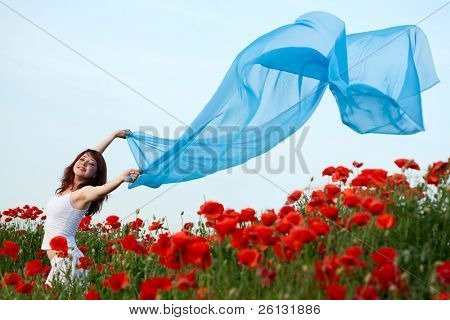 beauty woman in poppy field with tissue