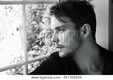 Good Looking Man Siting In Bay Window Seat