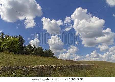 Limestone Wall, Cumulus Clouds, Blue Sky, Tallgrass Prairie National Preserve, Kansas