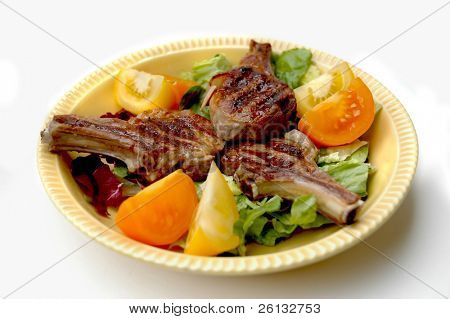 Lamp Chops on a bed of lettuce with sliced tomatoes
