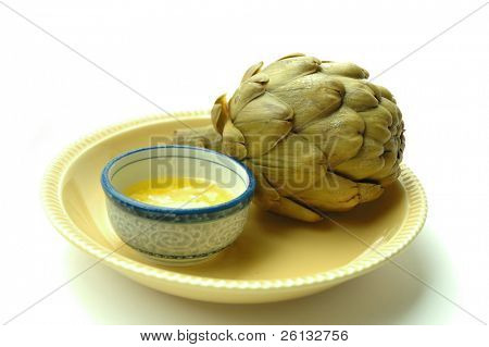 Steamed artichoke with melted butter