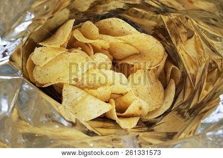 Close-up Look Inside A Bag Of Potato Chips Or Packet Of Crisps, Cheese And Onion Flavor