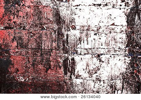 Deteriorating painted brick wall stylized with grunge effects