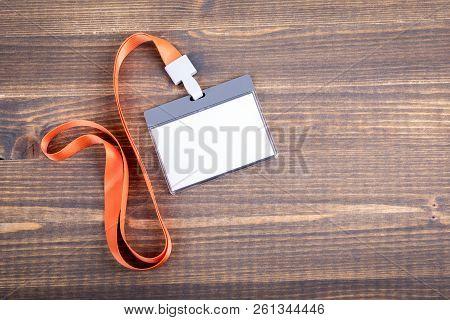 White Empty Staff Identity Mockup With Orange Lanyard. Name Tag, Id Card. Wood Texture Background