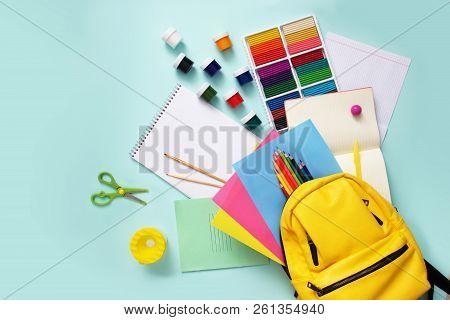 School Stationary Sets And Knapsack On Blue Background.