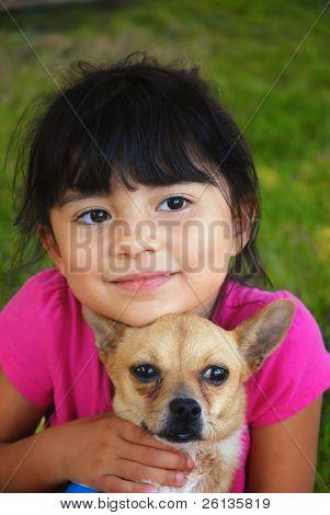 Pretty hispanic girl holding her chihuahua