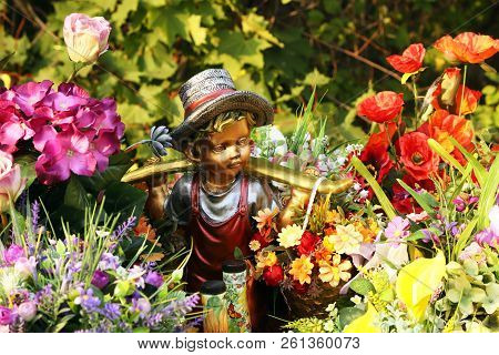 Garden Boy Figurine In Colors. Garden Design