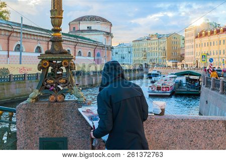 Saint Petersburg, Russia- October 3,2016. Unidentified Artist Painting The Embankment Of Moika River