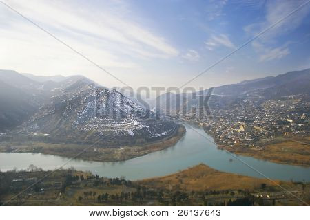 river junction on mountains and sky background