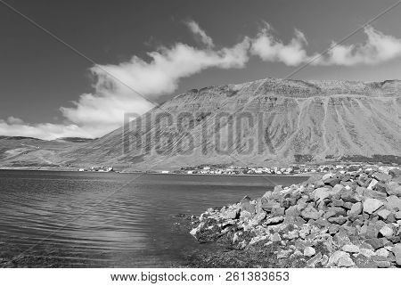 Hilly Coastline On Sunny Blue Sky In Isafjordur, Iceland. Mountain Landscape Seen From Sea. Summer V