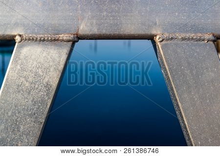 Welded Aluminum Beam Pipes In An Arc With Water Framed In The Center