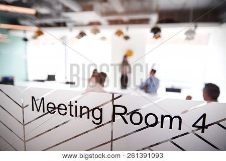 Boardroom Presentation Viewed Through Meeting Room Window