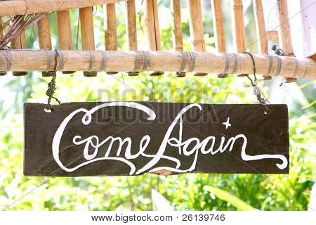 come again phrase on wooden board