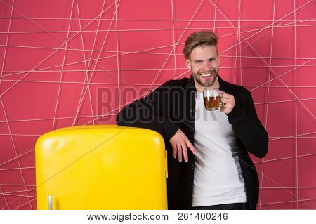 Morning Teas To Jump Start Your Day. Man Cheerful Smile With Morning Drink Near Refrigerator. Bachel