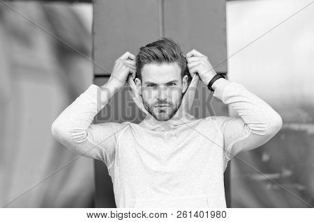 Feeling Casual. Guy Bearded Attractive Casual Hooded. Man With Bristle Serious Face, Urban Backgroun