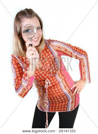 girl looking through magnifier glass over white