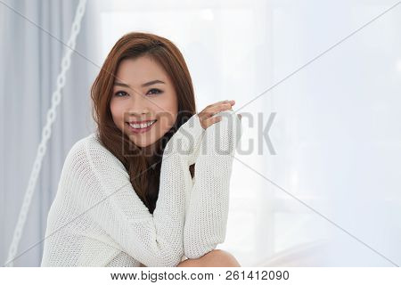 Portrait Of Young Attractive Asian Woman Smilng And Looking At Camera