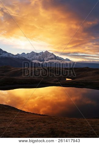 Landscape with mountain lake Koruldi. Main Caucasian ridge. Samegrelo-zemo svaneti, Georgia. Dawn with a beautiful sky and clouds