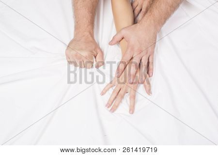 Female hand pulling white sheets in ecstasy, orgasm. Concept of passion. Erotic moments.Sex couple. Bedroom. poster