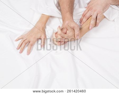 couple hands pulling white sheets in ecstasy, orgasm. Concept of passion. Orgasm. Erotic moments. Intimate concept. Sex couple. Bedroom. poster